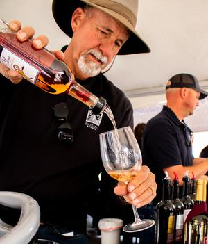 Man pouring a local Pinot Grigio into a glass during the Wine Festival